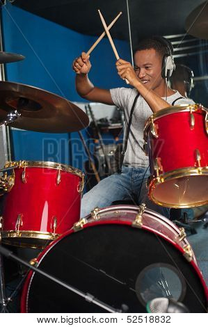 Cheerful Musician Playing Drums