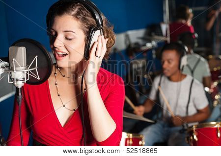 Lady Singing In Recording Studio