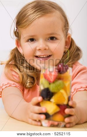 Happy Girl With Fruit Salad Or Drink