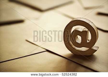 E-mail symbol on brown business letters