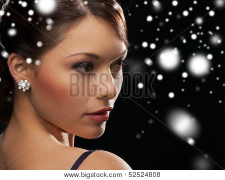 luxury, vip, nightlife, party, christmas, x-mas, new year's eve concept - beautiful woman in evening dress wearing diamond earrings