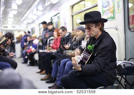 SAINT-PETERSBURG - APR 7: Musician wearing a hat playing a guitar in the subway, April 7, 2013, St.Petersburg, Russia
