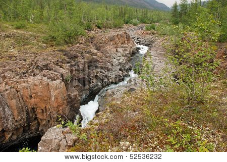 Mountain River In The Rocks.