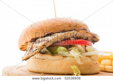 Grilled chicken burger with french fries isolated on white background