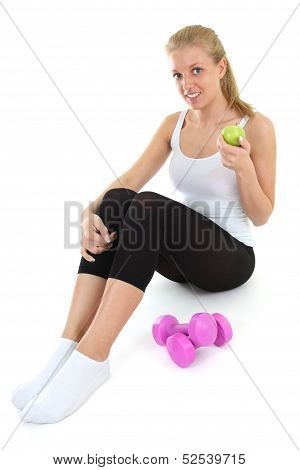 Young Blondie Woman Sitting With Dumbbells And Apple
