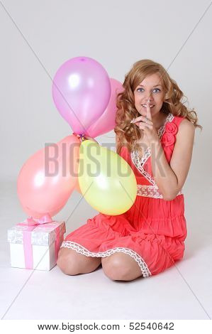 Birthday Girl With Gift And Balloons Showing Shh Sign