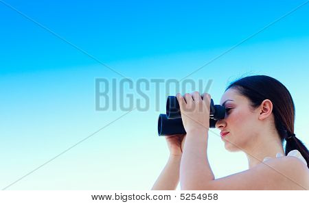 Businesswoman Looking Through Binoculars With Copy-space