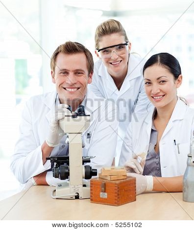 Young Scientists Working With A Microscope