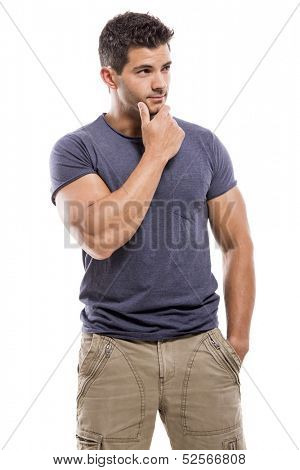 Handsome latin man with a thinking expression, isolated over a white background