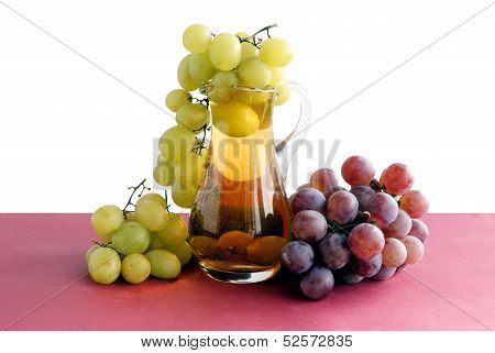 clusters of grapes and phial with wine
