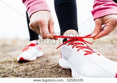Woman Runner Tying Sport Shoes