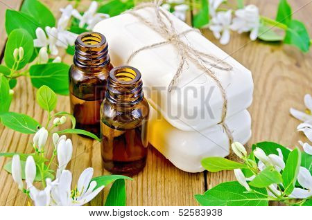 Oil And White Soap With Flowers Of Honeysuckle