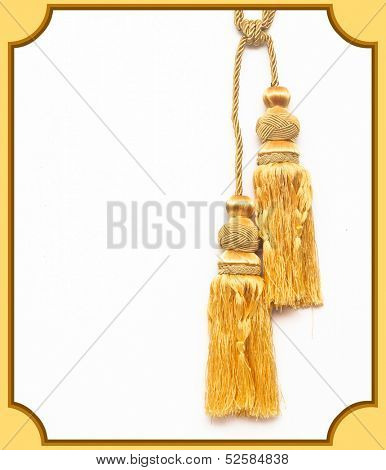 golden knot top tassel isolated on white background