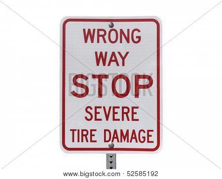 Wrong way stop severe tire damage sign.