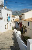stock photo of costa blanca  - Stairs leading down a street of Altea old town Costa Blanca Spain