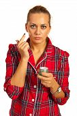 pic of pyjama  - Woman in pyjamas applying lotion before bed isolated on white background - JPG