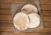 Pitta Bread (lebanese Bread), Over Old Burlap Background
