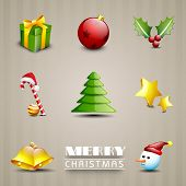 Glossy Merry Christmas ornament set on abstract brown background.