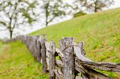 stock photo of split rail fence  - Rustic home made split rail fence in the mountains of North Carolina and virginia