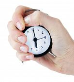 stock photo of stop hate  - Alarm clock in hand isolated on white - JPG