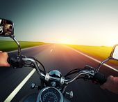pic of pov  - Driver riding motorcycle on an empty asphalt road - JPG