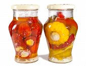 foto of marinade  - Marinaded tomatoes stuffed and bush pumpkins and vegetable marrows in a glass jar - JPG