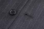 stock photo of eyeleteer  - button and eyelet of a pinstriped jacket - JPG