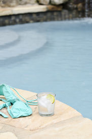 picture of skinny-dip  - bikini and a cold beverage by the pool