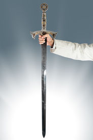 image of longsword  - a hand holding a long and ornated medieval steel sword - JPG
