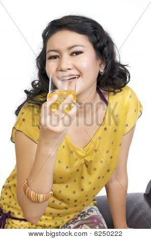 Model Sitting On Chair And Drink Orange Juice