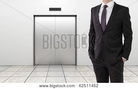 Businessman And Modern Elevator