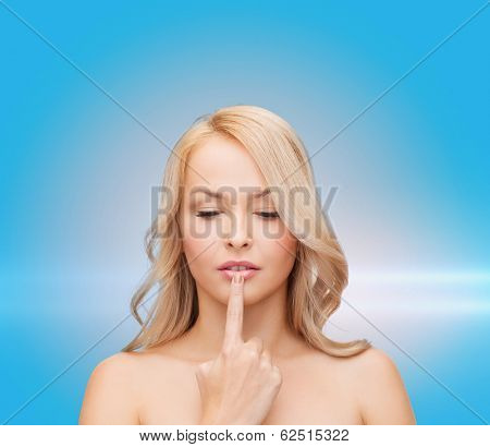 health and beauty concept - beautiful woman touching her lips
