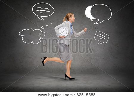 business, time and education concept - smiling young businesswoman with clock running