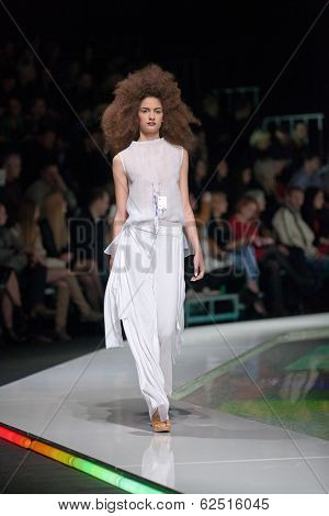 ZAGREB, CROATIA - MARCH 28, 2014: Fashion model wearing clothes designed by Marina Design and Marija Ivanovic necklace on the 'Fashion.hr' fashion show