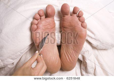 Woman Tickling Mans Foot
