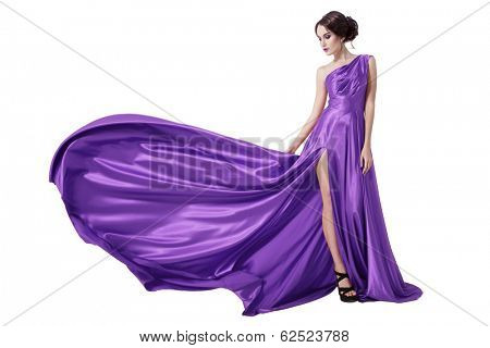 Young Beauty Woman In Fluttering Violet Dress. Isolated On White Background.