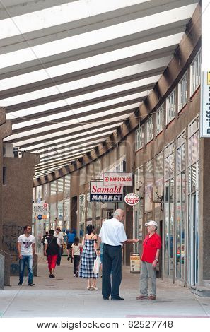 NOVI PAZAR, SERBIA - 26 July: shoppers walk along AVNOJ-a covered shopping street on July 26, 2013 in Novi Pazar downtown. Novi Pazar means