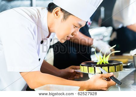 Side view of young chef decorating cake