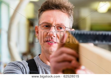 Carpenter working with angle in his workshop or carpentry