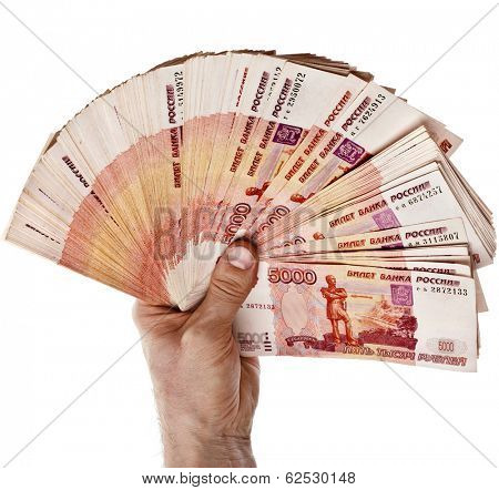 Fan of One Million Banknotes Rubles of the Russian Federation in man hand - isolated on white background