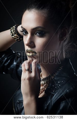Gorgeous beautiful sexy woman in a leather clothes