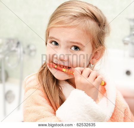 Cute Little Girl Brushing Teeth In Bath