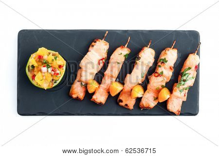 Skewered salmon (yakitori) with sauce isolated on white