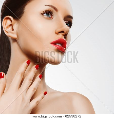 closeup woman portrait with red nails and lips