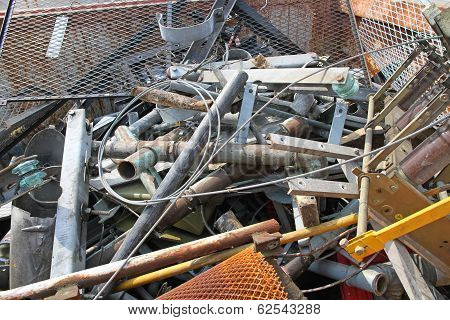 Piles Of Scrap Iron With Broken And Rusted Objects
