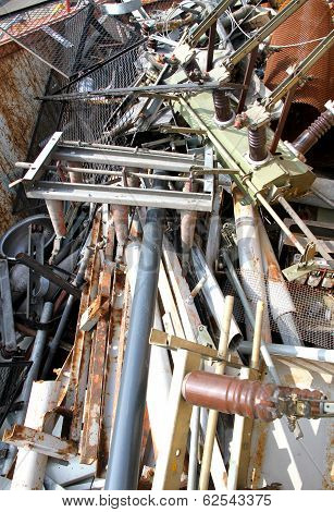 Scrap Iron With Broken And Rusted Objects In A Special Waste Landfill