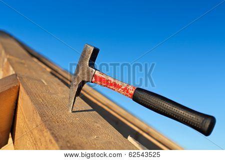 Carpenter Hammer Stuck Into A Wooden Beam