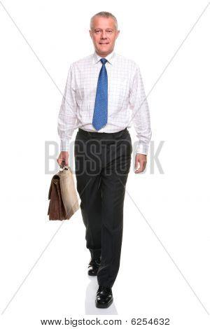 Mature Businesman Walking Towards