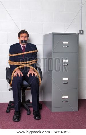 Businessman Tied Up In The Office