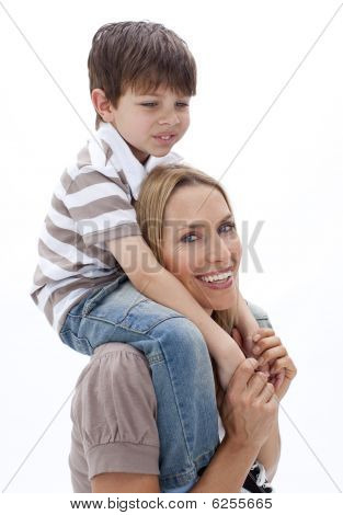 Close-up Of Mother Giving Son Piggyback Ride